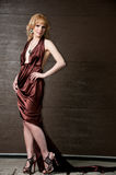 Pretty confident blonde girl in evening dress. Stock Photography