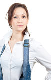 Pretty confident girl in a white shirt and denim Stock Photos