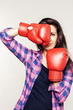 Pretty confident woman with boxing gloves Royalty Free Stock Photo