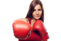 Pretty confident young woman with boxing gloves Stock Photos