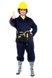 Pretty construction worker gesturing success Stock Images
