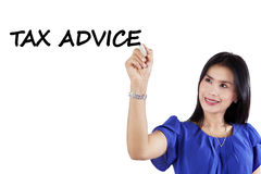 Pretty consultant writes tax advice Stock Photos