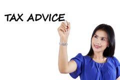 Pretty consultant writes tax advice Stock Photos