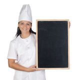 Pretty cook girl with blank slate Royalty Free Stock Photos
