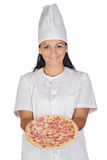 Pretty cook girl with a delicious pizza Royalty Free Stock Photography