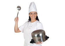 Pretty cook girl hitting a pot Stock Photography