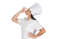 Pretty cook girl saying delicious Royalty Free Stock Images