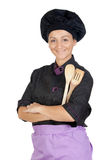 Pretty cook girl with wooden cookware Stock Photos