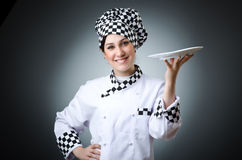 Pretty cook. With kitchen utensils Stock Photography