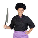 Pretty cook woman with big knife Stock Photo