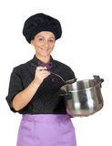 Pretty cook woman with big pot Royalty Free Stock Image