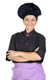 Pretty cook woman with black uniform Royalty Free Stock Image