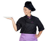 Pretty cook woman with black uniform Stock Photos