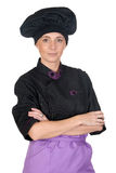 Pretty cook woman with black uniform Royalty Free Stock Photography