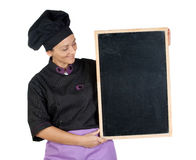 Pretty cook woman with blackboard Stock Image
