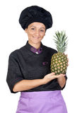 Pretty cook woman with pineapple Royalty Free Stock Photos