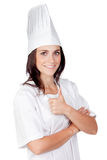 Pretty cook woman saying Ok Stock Photo
