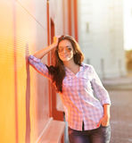 Pretty cool girl posing against colorful wall Royalty Free Stock Images