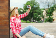 Pretty cool girl taking picture self portrait on smartphone Royalty Free Stock Photography