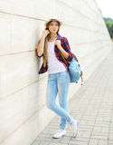 Pretty cool girl wearing a straw hat, shirt and backpack royalty free stock photography