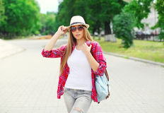 Pretty cool girl wearing a summer straw hat outdoors in summer. Park Stock Image