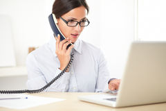 Pretty corporate employee speaking on the phone Royalty Free Stock Photography