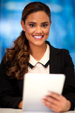 Pretty corporate lady holding tablet pc Stock Photos