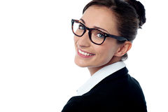Pretty corporate woman turning back Stock Photography