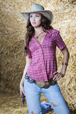 Pretty country cowgirl in hay Stock Photos
