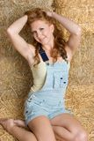 Pretty Country Girl. In hay Royalty Free Stock Image