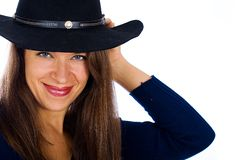 Pretty country girl with a cowboy hat Royalty Free Stock Images
