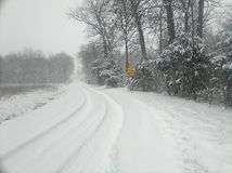 Pretty country winter scenery during snowstorm stock photos