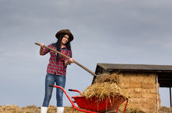Pretty country woman working with animal manure Royalty Free Stock Photo