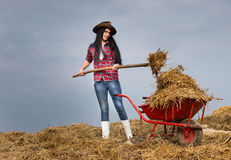 Pretty country woman working with animal manure Stock Photography