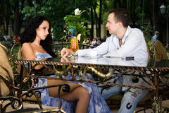 Pretty couple in the cafe. Lovers sit in the cafe. They talk about love Royalty Free Stock Image