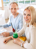 Pretty couple dating moment in cozy sunny restaurant Stock Image