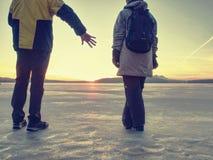 Pretty couple have fun on beach. Winter walk at frozen sea royalty free stock image