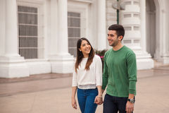 Pretty couple holding hands and walking Royalty Free Stock Image