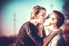 Pretty couple kissing outdoor in the forest Royalty Free Stock Images