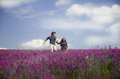 Pretty couple laughing at lavender field. Stock Photography