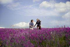 Pretty couple laughing at lavender field. Stock Images