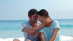 Pretty couple looking at each other at the beach stock video footage