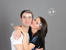 Pretty couple in love blowing bubbles Royalty Free Stock Photos