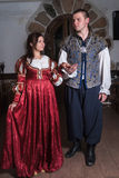 Pretty couple in medieval era costumes Royalty Free Stock Photos