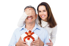 Pretty couple offering present to husband Royalty Free Stock Photos