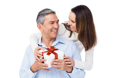 Pretty couple offering present to husband Royalty Free Stock Images