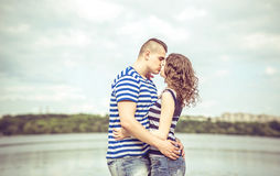 Pretty couple outdoor with lake on background Stock Photos