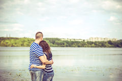 Pretty couple outdoor with lake on background Stock Image