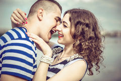 Pretty couple outdoor with lake on background Royalty Free Stock Images