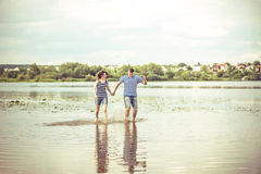 Pretty couple outdoor, running on the lake Stock Images